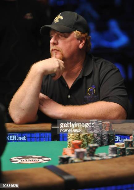 Player Darvin Moon from Oakland Maryland waits for his cards at the final table at the 2009 World Series of Poker at the Penn Teller Theater at the...
