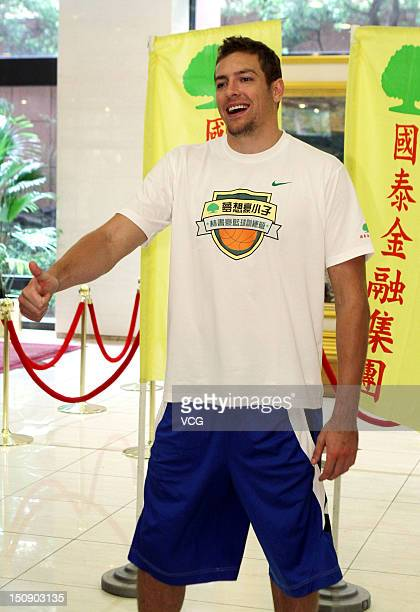 NBA player David Lee of the Golden State Warriors plays basketball with young kids at a Jeremy Lin Basketball Camp at Taipei Physical Education...