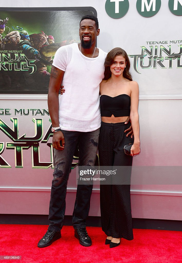 NBA player DeAndre Jordan and model Amber Alvarez attend Paramount Pictures' 'Teenage Mutant Ninja Turtles' premiere at Regency Village Theatre on August 3, 2014 in Westwood, California.