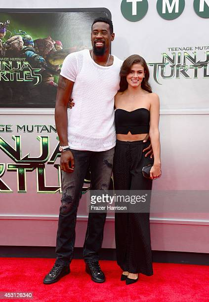 NBA player DeAndre Jordan and model Amber Alvarez attend Paramount Pictures' 'Teenage Mutant Ninja Turtles' premiere at Regency Village Theatre on...