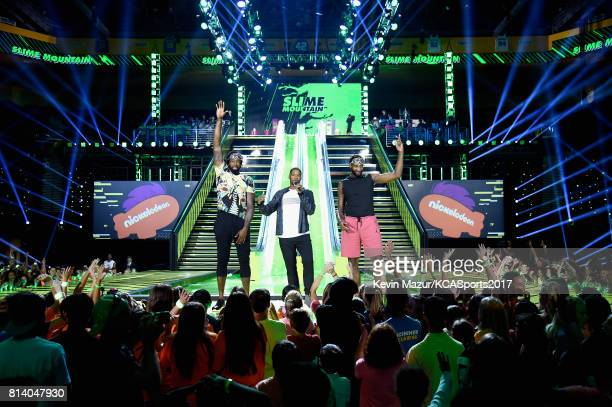 NBA player DeAndre Jordan Michael Strahan and NBA player Andre Drummond speak onstage during Nickelodeon Kids' Choice Sports Awards 2017 at Pauley...