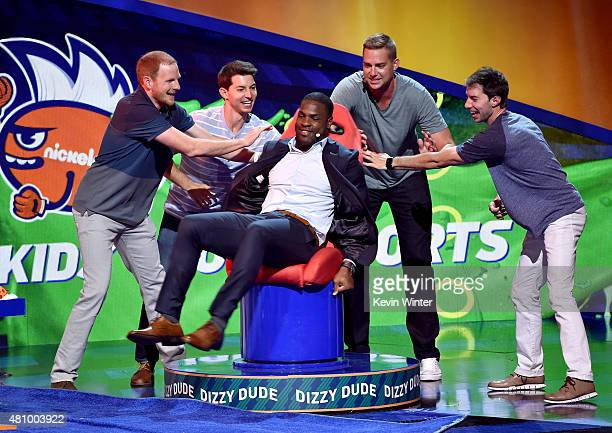NFL player DeMarco Murray rides the Dizzy Dude with members of Dude Perfect at the Nickelodeon Kids' Choice Sports Awards 2015 at UCLA's Pauley...