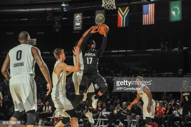 NBA player Dennis Shroder from the Atlantic Hawks slam dunks during the NBA Africa Game 2017 basketball match between Team Africa and Team World on...