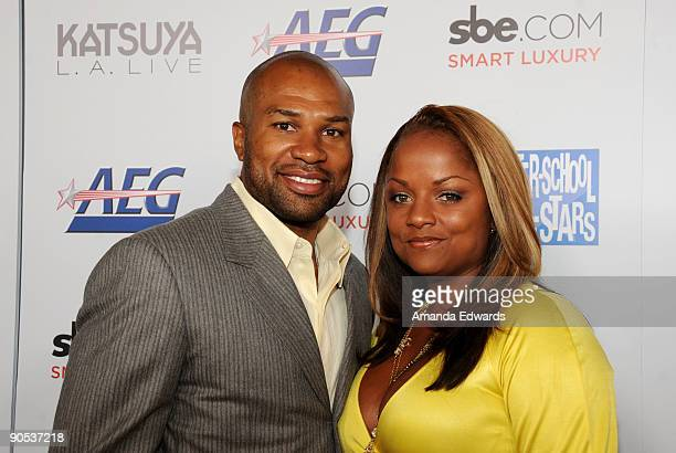NBA player Derek Fisher and his wife Candace arrive at the grand opening of Katsuya LA Live on September 9 2009 in Los Angeles California