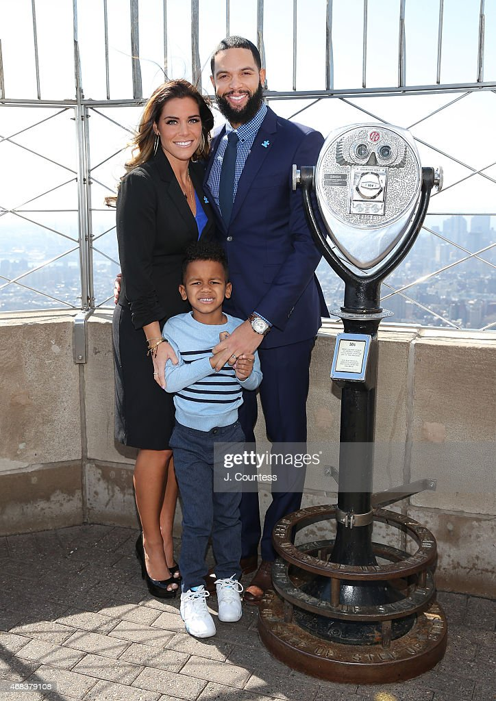 Player Deron Williams (R), Amy Young Williams and DJ Williams pose for a photo at The Empire State Building following a special Lighting ceremony to light The Empire State Building Blue In Celebration Of World Autism Awareness Day on April 2, 2015 in New York City.