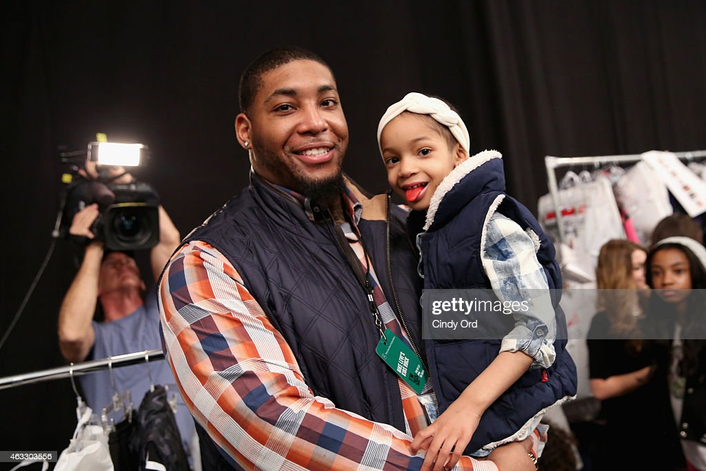 NFL player Devon Still and daughter prepare backstage at the Nike Levi's Kids fashion show during MercedesBenz Fashion Week Fall 2015 at The Salon at...