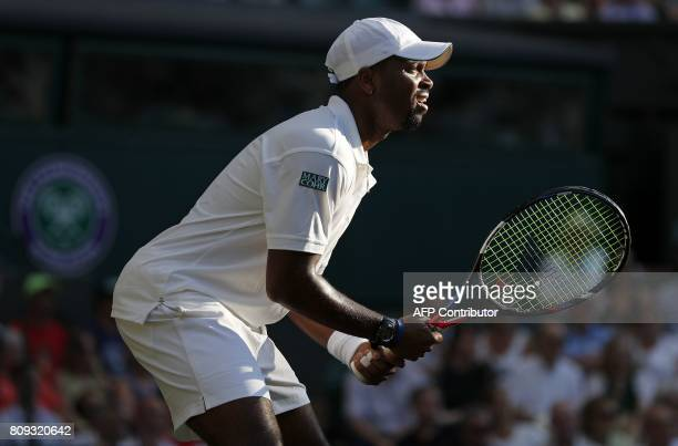 US player Donald Young waits to receive a serve from Spain's Rafael Nadal during their men's singles second round match on the third day of the 2017...