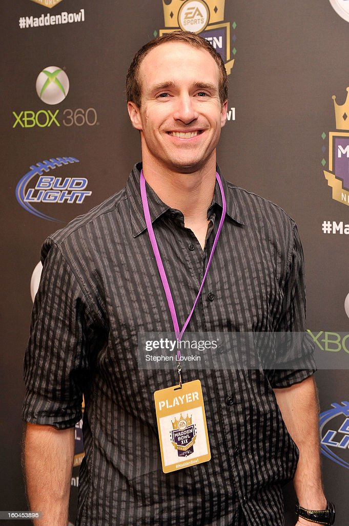 NFL player Drew Brees of the New Orleans Saints arrives at EA SPORTS Madden Bowl XIX at the Bud Light Hotel on January 31 2013 in New Orleans...