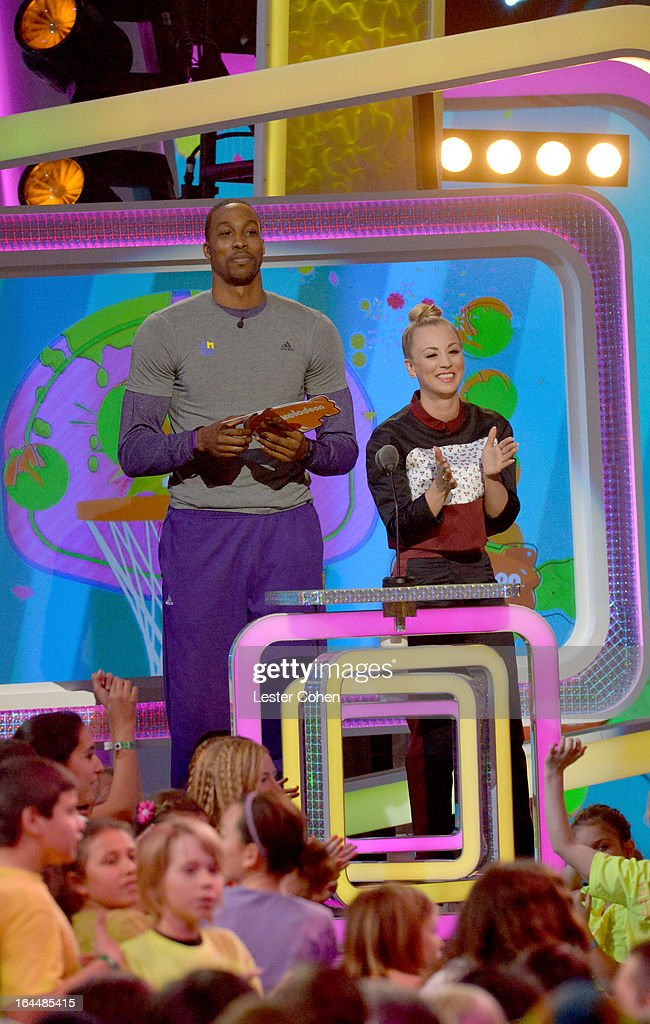 NBA player <a gi-track='captionPersonalityLinkClicked' href=/galleries/search?phrase=Dwight+Howard&family=editorial&specificpeople=201570 ng-click='$event.stopPropagation()'>Dwight Howard</a> (L) and actress <a gi-track='captionPersonalityLinkClicked' href=/galleries/search?phrase=Kaley+Cuoco&family=editorial&specificpeople=208988 ng-click='$event.stopPropagation()'>Kaley Cuoco</a> perform during Nickelodeon's 26th Annual Kids' Choice Awards at USC Galen Center on March 23, 2013 in Los Angeles, California.