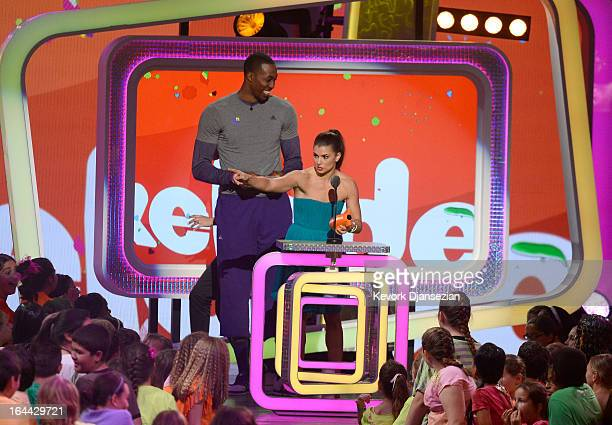 NBA player Dwight Howard and NASCAR driver Danica Patrick winner of Favorite Female Athlete speak onstage during Nickelodeon's 26th Annual Kids'...