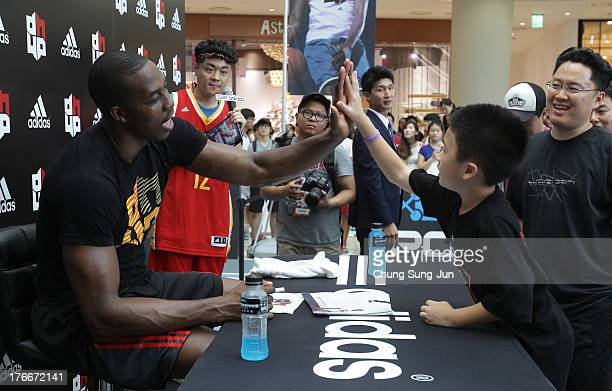 NBA player Dwight Howard of the Houston Rocket attends the autograph and fan meeting session during a promotional tour of South Korea at Time Square...