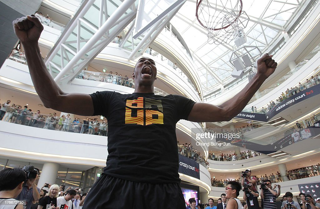 NBA player <a gi-track='captionPersonalityLinkClicked' href=/galleries/search?phrase=Dwight+Howard&family=editorial&specificpeople=201570 ng-click='$event.stopPropagation()'>Dwight Howard</a> of the Houston Rocket attends the autograph and fan meeting session during a promotional tour of South Korea at Time Square on August 17, 2013 in Seoul, South Korea.