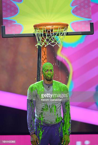 NBA player Dwight Howard performs onstage during Nickelodeon's 26th Annual Kids' Choice Awards at USC Galen Center on March 23 2013 in Los Angeles...