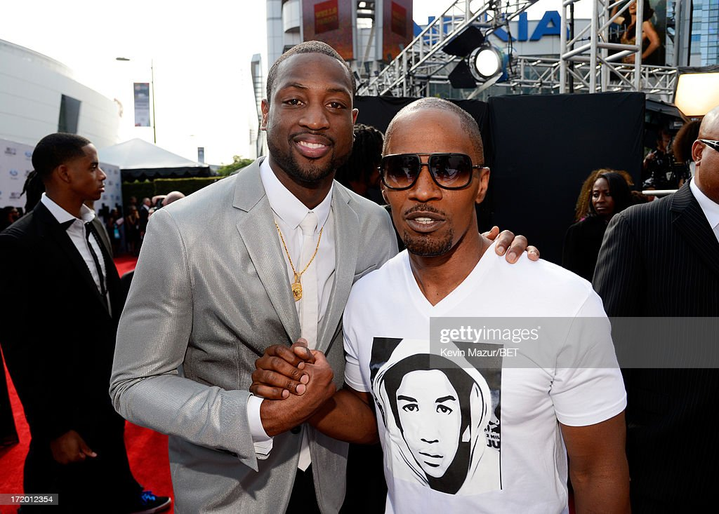 NBA player <a gi-track='captionPersonalityLinkClicked' href=/galleries/search?phrase=Dwyane+Wade&family=editorial&specificpeople=201481 ng-click='$event.stopPropagation()'>Dwyane Wade</a> (L) and actor <a gi-track='captionPersonalityLinkClicked' href=/galleries/search?phrase=Jamie+Foxx&family=editorial&specificpeople=201715 ng-click='$event.stopPropagation()'>Jamie Foxx</a> attend the Ford Red Carpet at the 2013 BET Awards at Nokia Theatre L.A. Live on June 30, 2013 in Los Angeles, California.