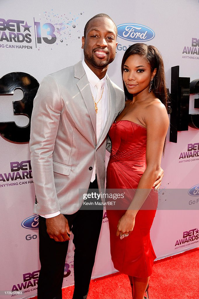 NBA player <a gi-track='captionPersonalityLinkClicked' href=/galleries/search?phrase=Dwyane+Wade&family=editorial&specificpeople=201481 ng-click='$event.stopPropagation()'>Dwyane Wade</a> and actress <a gi-track='captionPersonalityLinkClicked' href=/galleries/search?phrase=Gabrielle+Union&family=editorial&specificpeople=202066 ng-click='$event.stopPropagation()'>Gabrielle Union</a> attend the Ford Red Carpet at the 2013 BET Awards at Nokia Theatre L.A. Live on June 30, 2013 in Los Angeles, California.