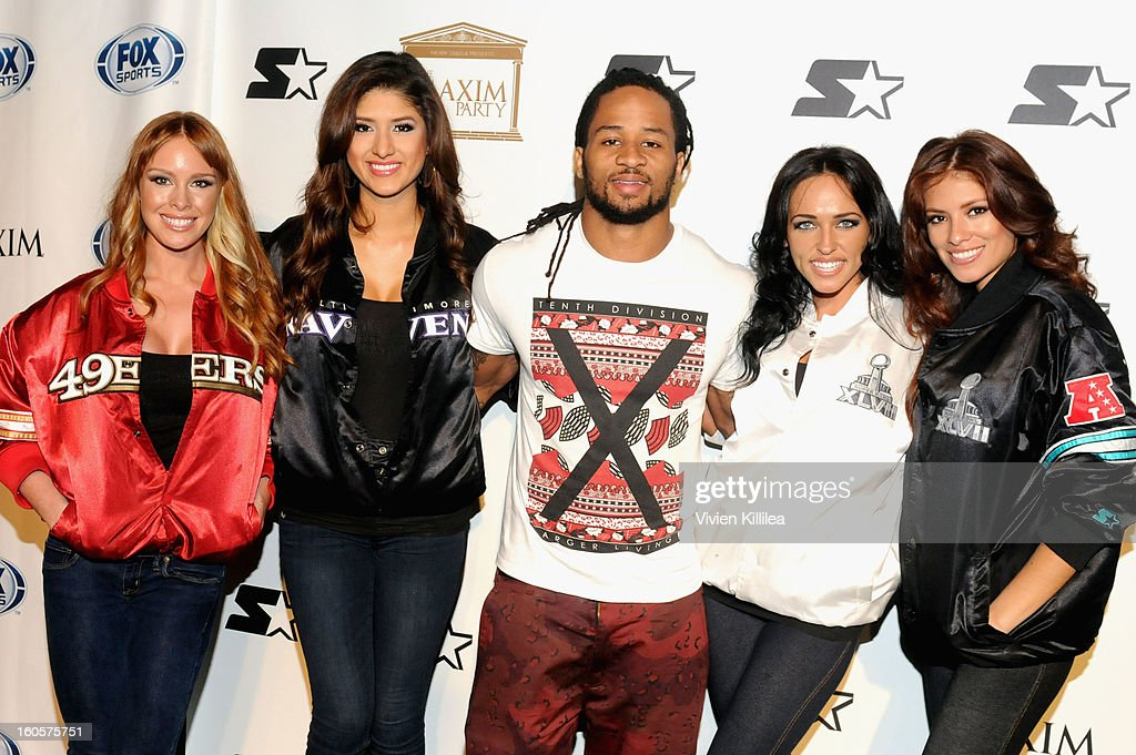 NFL player Earl Thomas (C) poses on the Starter Red Carpet at the Maxim Party during Super Bowl XLVII at Second Line Warehouse on February 2, 2013 in New Orleans, Louisiana.