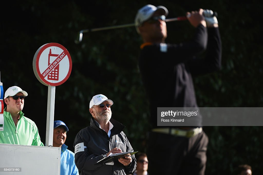 A player effiiciency survey staff member looks on during day one of the BMW PGA Championship at Wentworth on May 26, 2016 in Virginia Water, England.