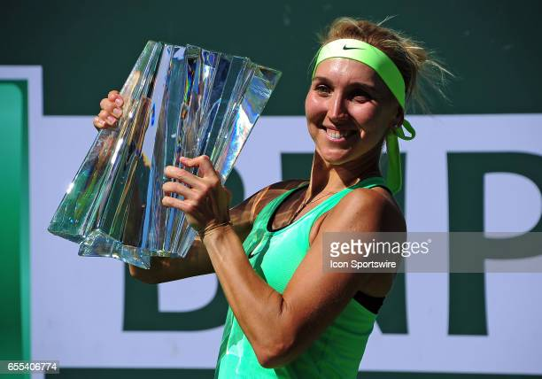 WTA player Elena Vesnina poses with the BNP Paribas Open winners trophy after defeating Svetlana Kuznetsova on March 19 67 75 64 in the finals to...
