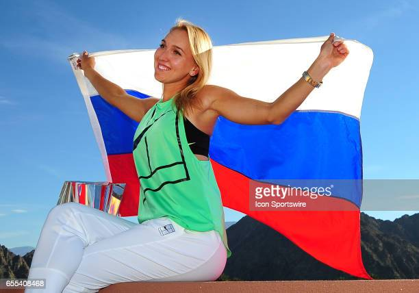 WTA player Elena Vesnina posses with the winners trophy and the flag of Russia after Vesnina defeated Svetlana Kuznetsova on March 19 67 75 64 to...
