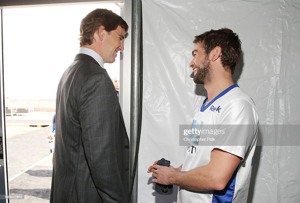 NFL player Eli Manning (L) and actor Chace Crawford attend DIRECTV'S Seventh Annual Celebrity Beach Bowl at DTV SuperFan Stadium at Mardi Gras World on February 2, 2013 in New Orleans, Louisiana.