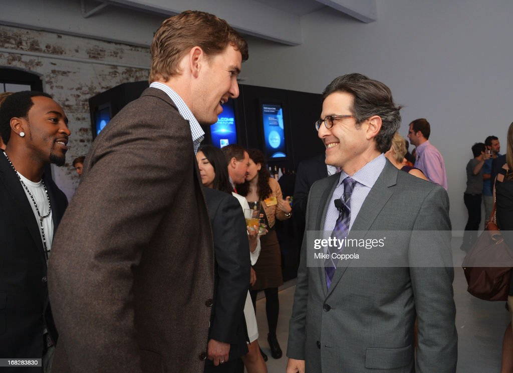 NFL player <a gi-track='captionPersonalityLinkClicked' href=/galleries/search?phrase=Eli+Manning&family=editorial&specificpeople=202013 ng-click='$event.stopPropagation()'>Eli Manning</a> (L) and DIRECTV Executive Vice President and Chief Revenue and Marketing Officer Paul Guyardo attend the DIRECTV's 2013 National Ad Sales Upfront on May 7, 2013 in New York City.