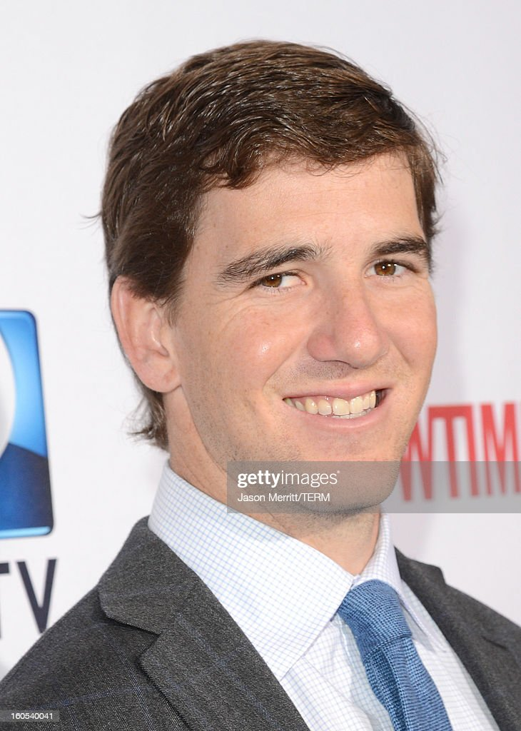 NFL player <a gi-track='captionPersonalityLinkClicked' href=/galleries/search?phrase=Eli+Manning&family=editorial&specificpeople=202013 ng-click='$event.stopPropagation()'>Eli Manning</a> attends DIRECTV'S Seventh Annual Celebrity Beach Bowl at DTV SuperFan Stadium at Mardi Gras World on February 2, 2013 in New Orleans, Louisiana.