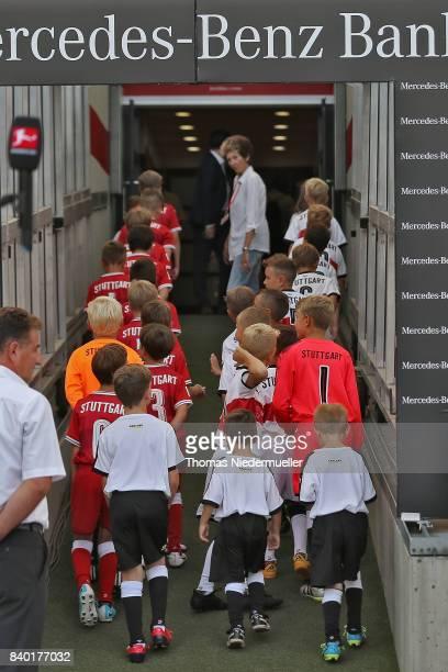 Player escort kids are seen prior to the Bundesliga match between VfB Stuttgart and 1 FSV Mainz 05 at MercedesBenz Arena on August 26 2017 in...
