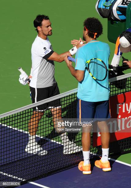 ATP player Fabio Fognini shakes hands with JoWilfried Tsonga after defeating Tsonga 76 36 64 during a match played on March 11 2017 during the BNP...