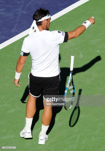 ATP player Fabio Fognini throws his racket to the court during the third set of a match against JoWilfried Tsonga played on March 11 2017 during the...