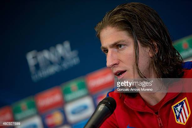 Player Filipe Luis of Atletico de Madrid attends questions from the media at Club Atletico de Madrid press conference during the Media Day prior to...