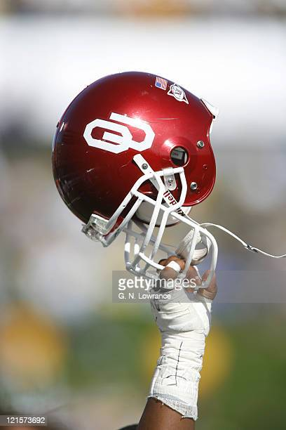 A player for Oklahoma hoists up his helmet during the 2ndhalf kickoff between the Oklahoma Sooners and the Missouri Tigers at Faurot Field in...