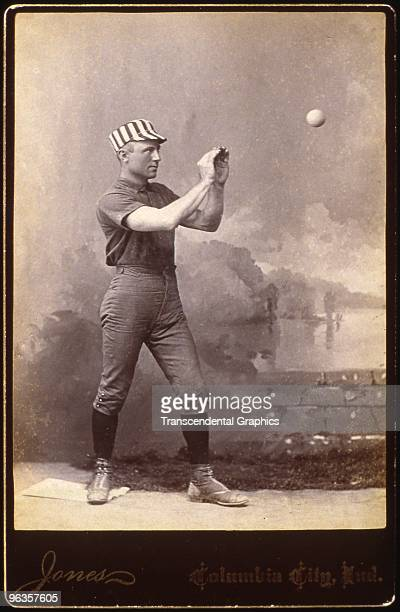 A player for the Columbia City Indiana baseball club poses as if catching a throw on a cabinet card during a photo session around 1886