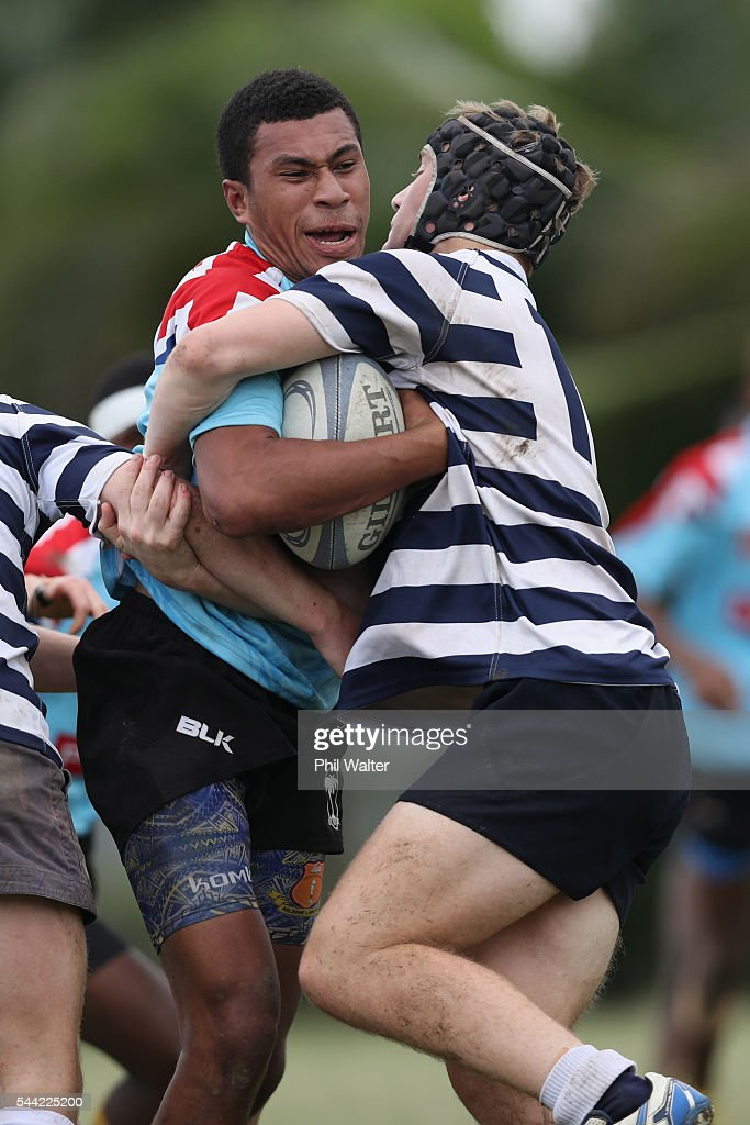 A player from Andhra Secondary School is tackled during the Fiji Schoolboy Rugby match between St Stanislaus College and Andhra Secondary School on July 2, 2016 in Nadi, Fiji.