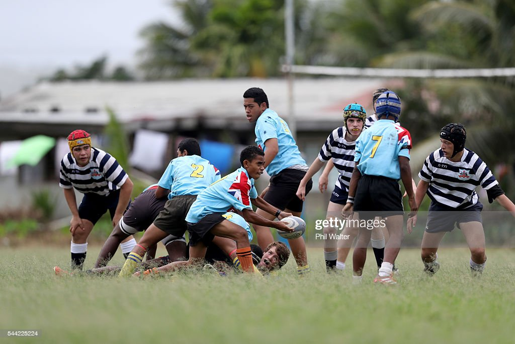 A player from Andhra Secondary School passes the ball during the Fiji Schoolboy Rugby match between St Stanislaus College and Andhra Secondary School on July 2, 2016 in Nadi, Fiji.