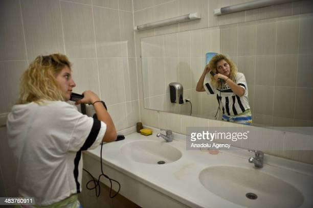 Player from Atasehir Belediyespor soccer team combs her hair at leisure in Istanbul Turkey on April 9 2014 Players of Atasehir Belediyespor in...