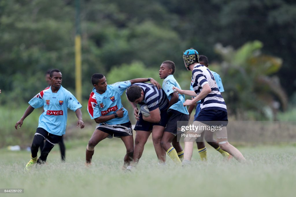 A player from St Stanislaus College is tackled during the Fiji Schoolboy Rugby match between St Stanislaus College and Andhra Secondary School on July 2, 2016 in Nadi, Fiji.