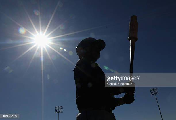 A player from the Seattle Mariners takes batting practice during a MLB spring training practice at Peoria Stadium on February 15 2011 in Peoria...