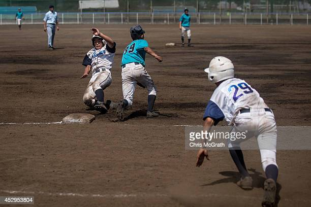 A player from the Shonan Boys slides into third base during a practice game between the Shonan Boys and the Yokohama Minami on July 30 2014 in...