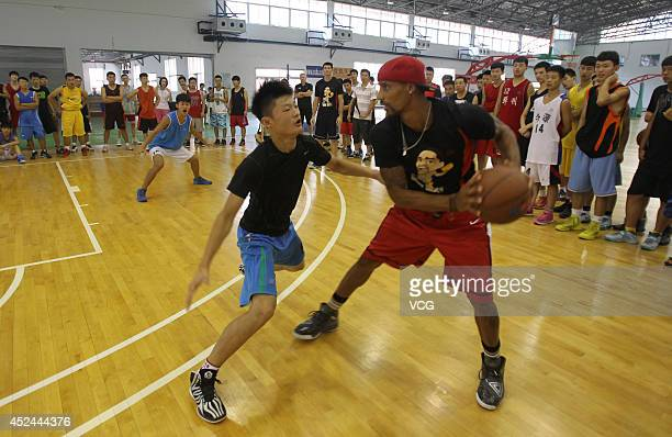 NBA player George Hill coaches students at George Hill China Basketball Training Center on July 20 2014 in Zhengzhou Henan province of China