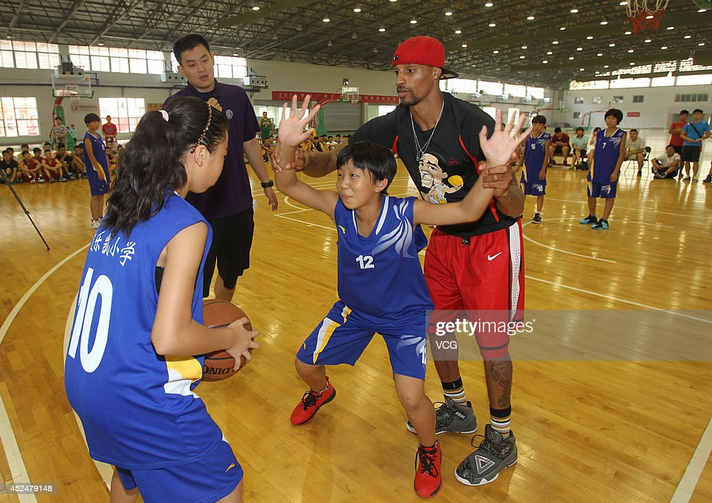 NBA player <a gi-track='captionPersonalityLinkClicked' href=/galleries/search?phrase=George+Hill+-+Basketball+Player&family=editorial&specificpeople=6831399 ng-click='$event.stopPropagation()'>George Hill</a> coaches students at <a gi-track='captionPersonalityLinkClicked' href=/galleries/search?phrase=George+Hill+-+Basketball+Player&family=editorial&specificpeople=6831399 ng-click='$event.stopPropagation()'>George Hill</a> China Basketball Training Center on July 20, 2014 in Zhengzhou, Henan province of China.
