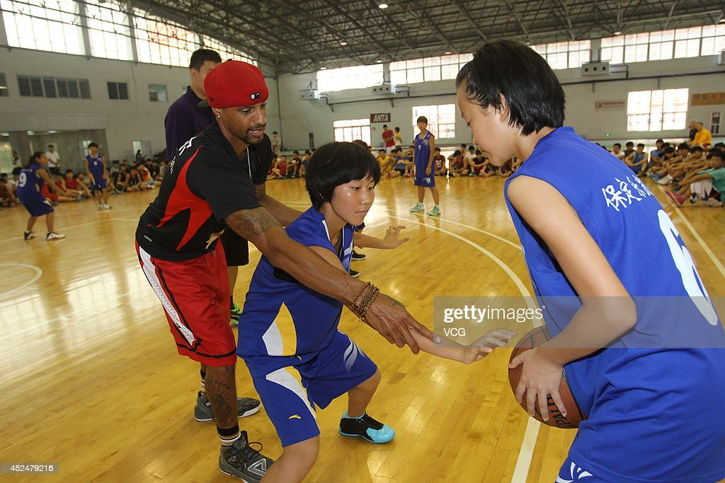 NBA player George Hill coaches students at George Hill China Basketball Training Center on July 20, 2014 in Zhengzhou, Henan province of China.
