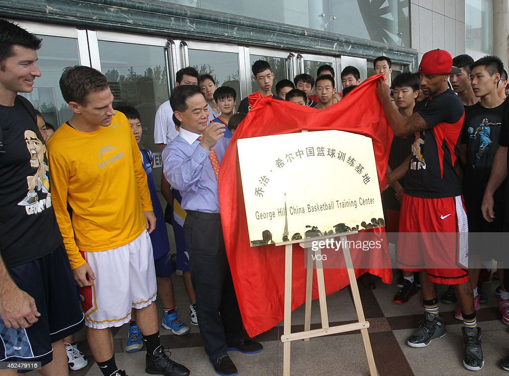 NBA player George Hill unveils the nameplate for the George Hill China Basketball Training Center on July 20, 2014 in Zhengzhou, Henan province of China.