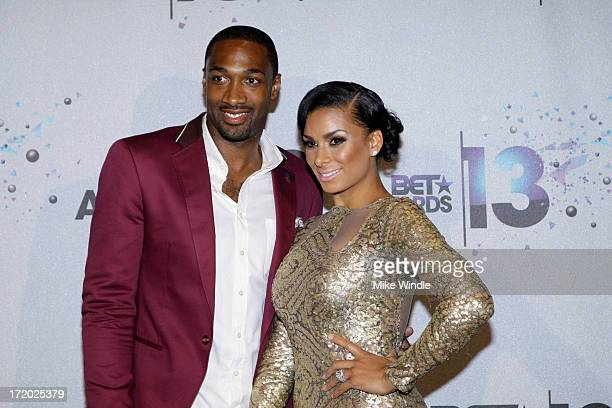 NBA player Gilbert Arenas and tv personality Laura Govan pose in the Backstage Winner's Room at Nokia Theatre LA Live on June 30 2013 in Los Angeles...