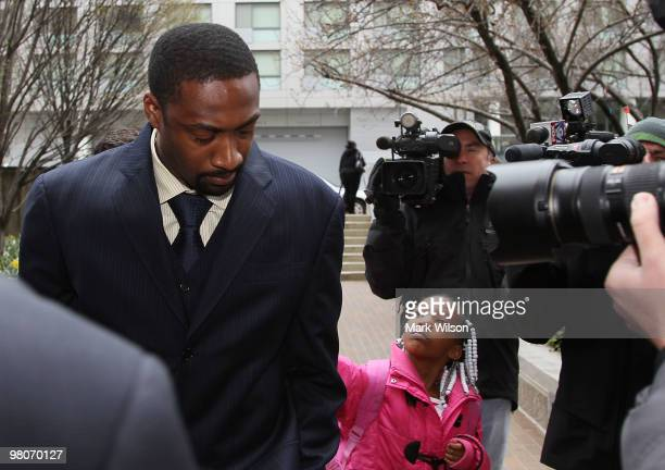 NBA player Gilbert Arenas of the Washington Wizards is asked for his autograph by 7yearold Meagan Tutt before he walks into the District of Columbia...