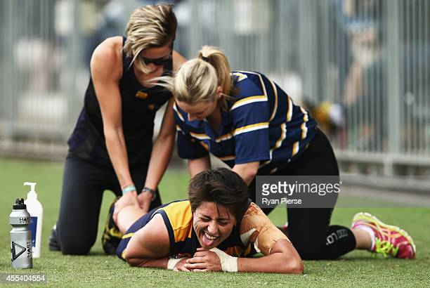 A player has a massage during the Sydney Women's AFL Grand Final match between Sydney University and UNSW/ES Stingrays at Blacktown Olympic Park on...