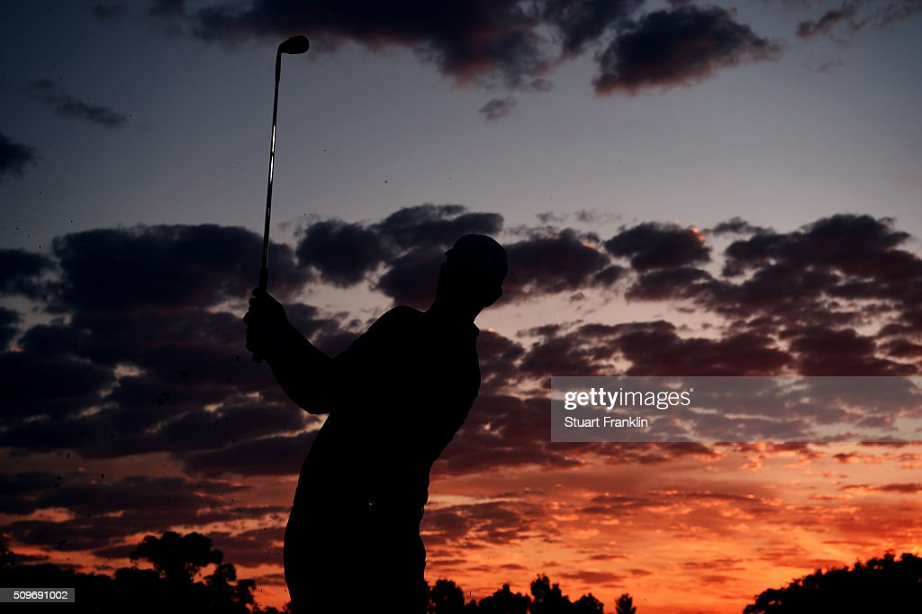A player hits a shot as he warms up at sunrise before the start of the second round of the Tshwane Open at Pretoria Country Club on February 12, 2016 in Pretoria, South Africa.