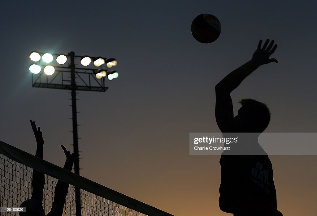 A player hits a spike shot as the sun sets during day two of the FIVB Qatar Open at The Al Gharafa Sports Club on November 05 2014 in Doha Qatar