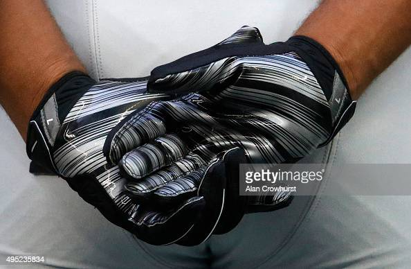 A player holds his gloved hands behing his back during the NFL game between Kansas City Chiefs and Detroit Lions at Wembley Stadium on November 01...