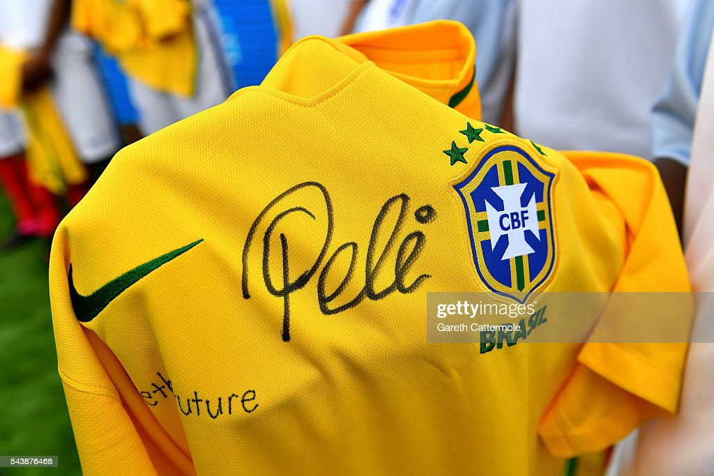 A player holds up a signed Pele shirt during the Energy Challenge photocall at Queen Elizabeth Olympic Park on June 30, 2016 in London, England. Pele has teamed up with Shell to launch the world's first human powered football pitch.