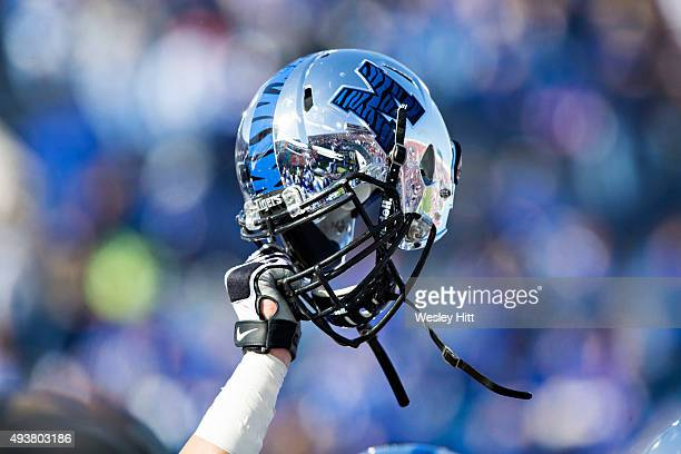 Player holds up helmet of the Memphis Tigers before a game against the Ole Miss Rebels at Liberty Bowl Memorial Stadium on October 17 2015 in Memphis...